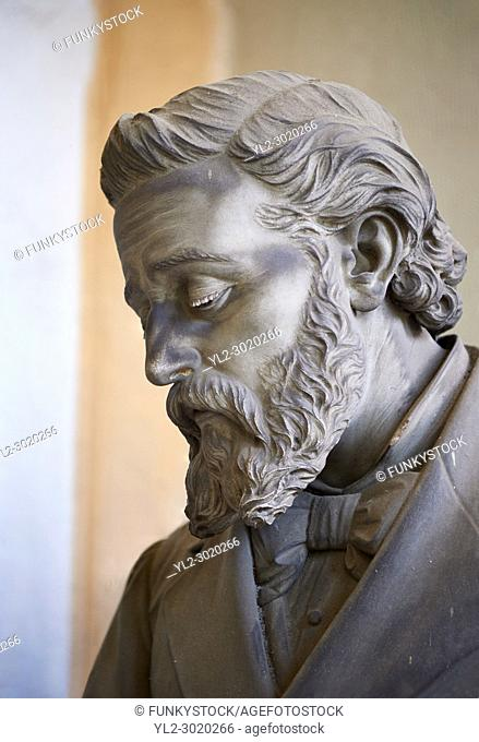 Picture and image of the stone sculpture of a mouring bearded man in the Bourgeois Realistic style. Badaracco Tomb sculpted by G Moreno 1878