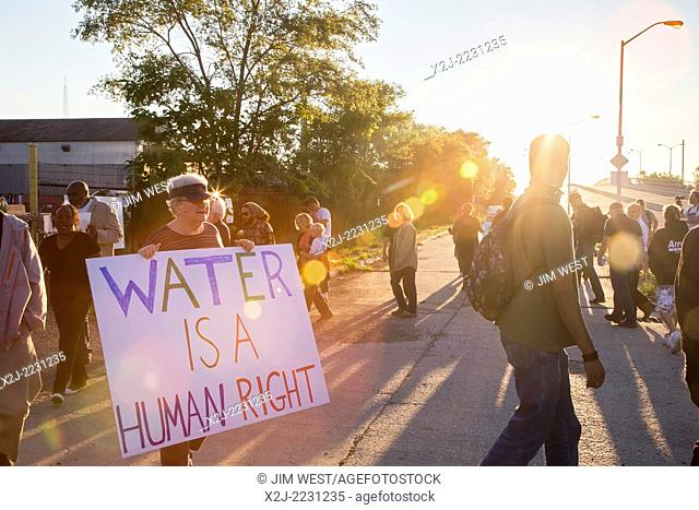 Detroit, Michigan - Religious and community activists block the entrance to Homrich, a contractor hired to shut off water service to Detroit residents
