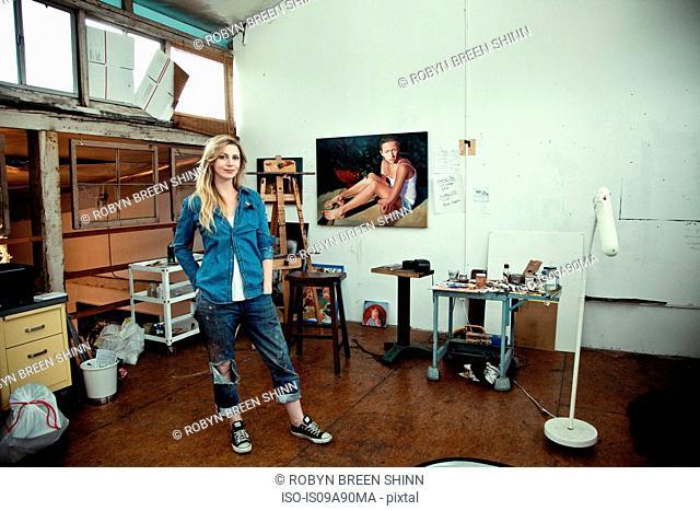 Mid adult woman standing in artist's studio, portrait