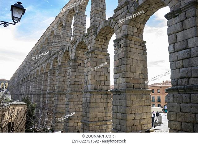 Tourist, Roman aqueduct of segovia. architectural monument declared patrimony of humanity and international interest by UNESCO. Spain