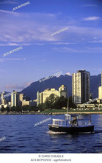View across English Bay to West End condos with aquabus, Vancouver, British Columbia, Canada