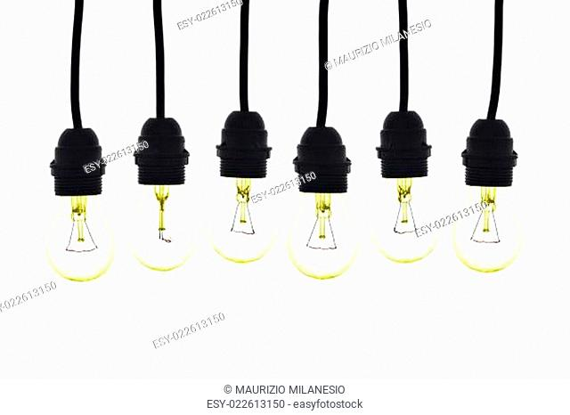 Light bulbs hanging colored yellow on white