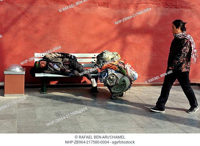 BEIJING - MARCH 11:Chinese homeless sleeeping outside The Forbidden City walls on March 11 2009 in Beijing,China More than 135 million people in China live on...