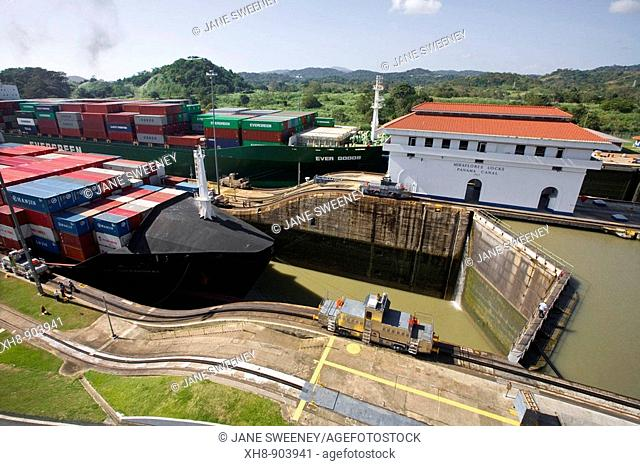 Mechanical mule or electric locomotive guiding container ship through Miraflores Locks, Panama Canal, Panama