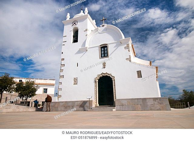 Typical small church bell tower located in Querenca, Portugal