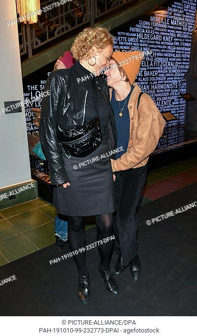 """09 October 2019, Berlin: Katja Riemann (l) and Jella Haase come to the premiere of """"""""Faith in the Possibility of the Complete Renewal of the World"""""""" in the..."""