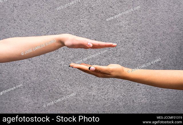 Studio shot of hands of two young women