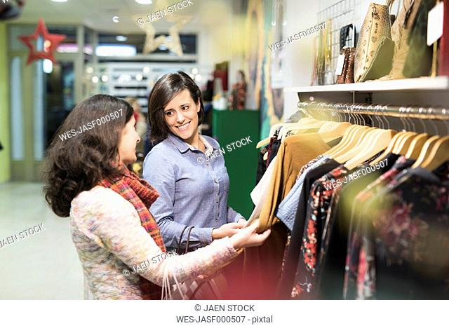 Friends shopping in fashion store