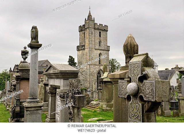 Church of the Holy Rude with Bell tower and Royal Cemetery with historic gravestones crosses and granite memorials on Castle Hill Stirling Scotland UK