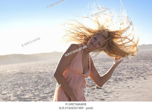 Girl shaking hair