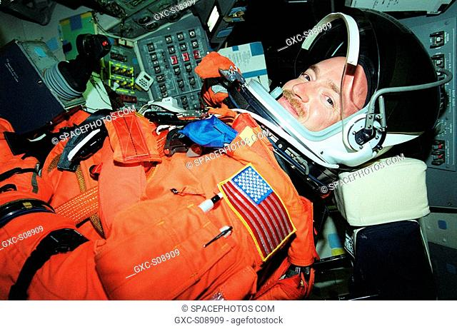 11/09/2001 - STS-108 Pilot Mark E. Kelly settles into his seat aboard Space Shuttle Endeavour prior to a simulated launch countdown