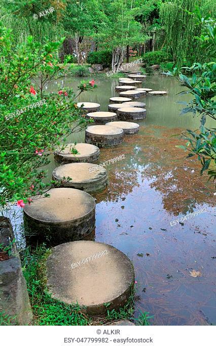 Element of landscape design, a stone path across the pond