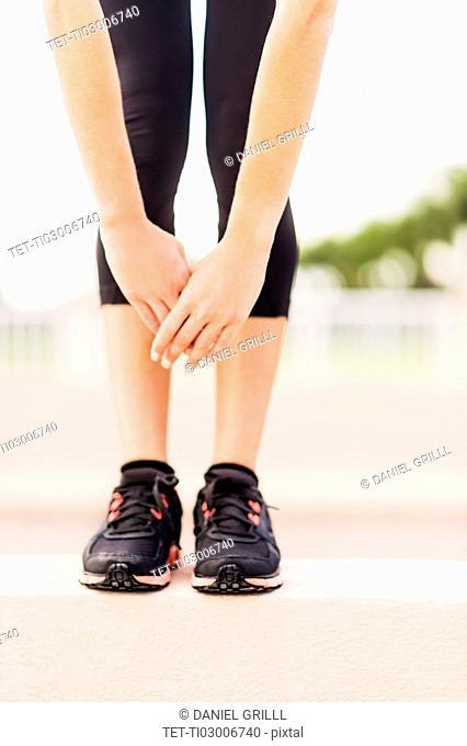 Legs of exercising woman