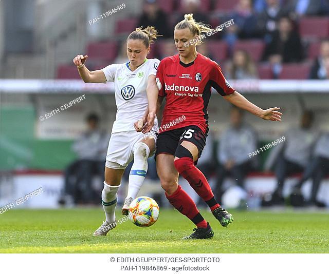 duels, duel between Ewa Pajor (VfL Wolfsburg) and Virginia Kirchberger (SC Freiburg). GES / Football / Women's DFB Cup Final: VfL Wolfsburg - SC Freiburg, 01