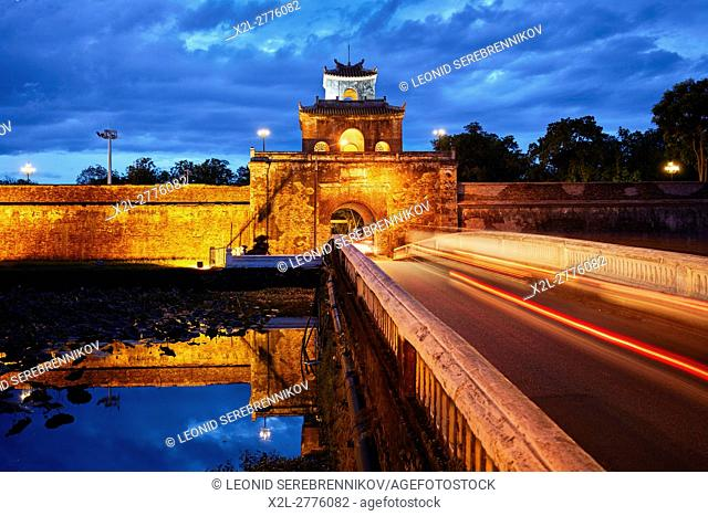 Moat and wall of The Citadel (Imperial City) illuminated at dusk. Hue, Vietnam