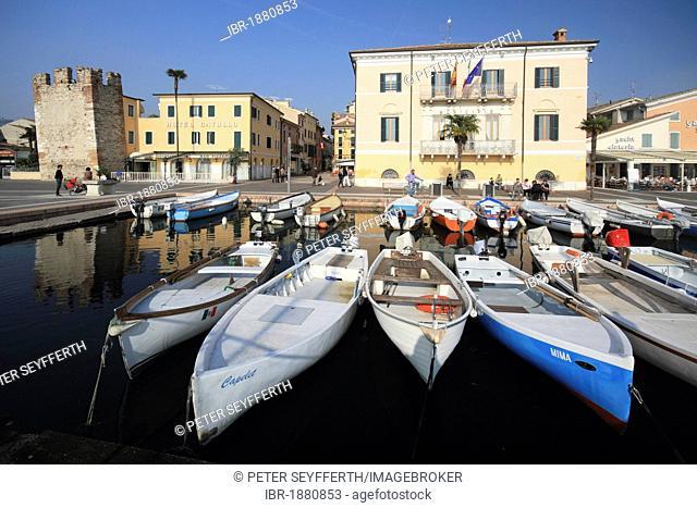 Fishing boats in the harbour and the lakeside promenade, Bardolino on Lake Garda, province of Verona, Veneto region, Italy, Europe