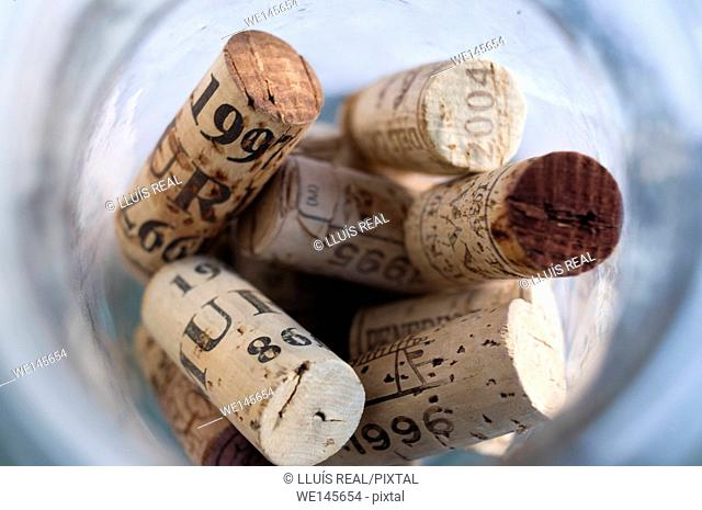 Above view of corks in glass jar