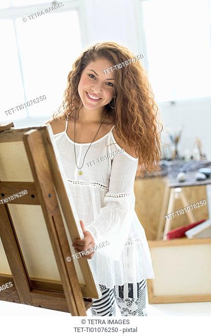 Young female artist in studio