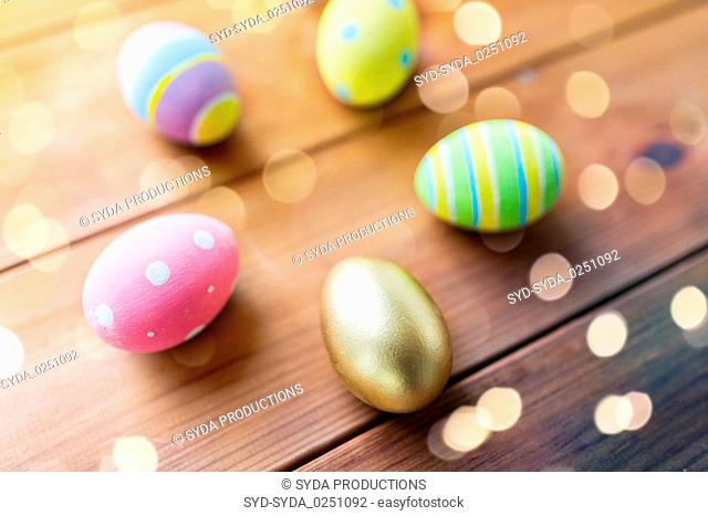 close up of colored easter eggs on wooden boards