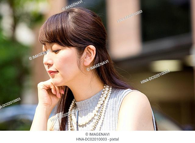 Woman resting her chin on her hands