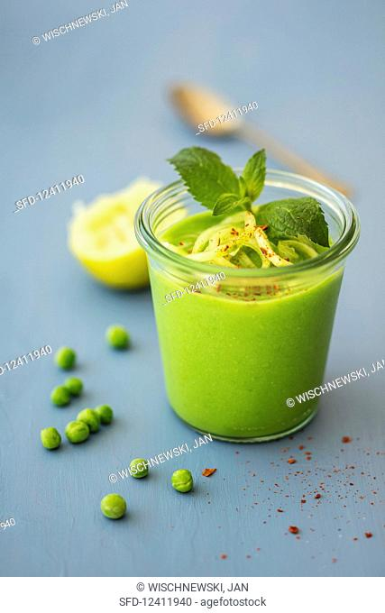 Cold pea soup with mint, lime juice and cucumber noodles (vegan)