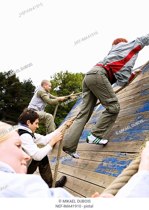 Young people in an assault course
