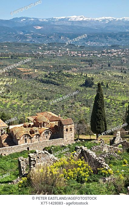 The hill of Mystra with its Byzantine ruins, looking down on the church of the Mitropolis Agios Dimitrios Near Sparta, Peloponnese, Greece