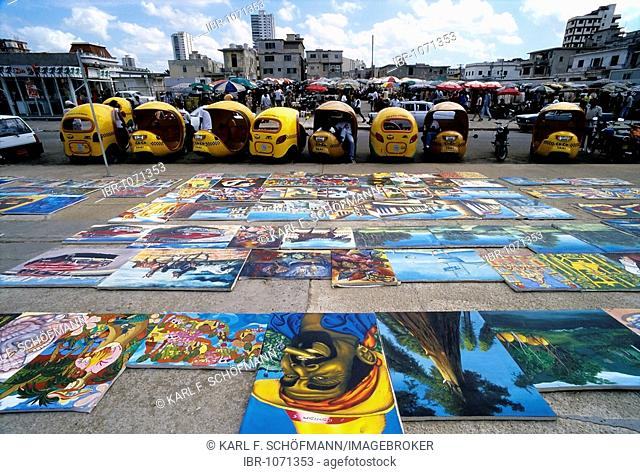 Flea market, Cuban paintings on the floor, spread out for sale, Vedado, Havana, Cuba, Caribbean