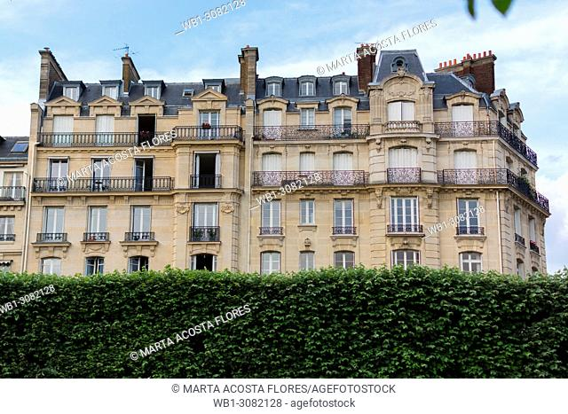 Haussmannian building facade in a sunny day. Paris, France