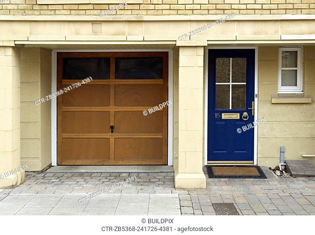 Front door and wooden garage door, Ingress Park, Kent, UK