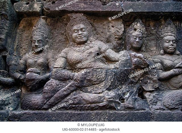 Sandstone bas relief of the Leper King with devatas in the underworld on the hidden wall at the Leper King Terrace, part of the Royal Square of Angkor Thom -...