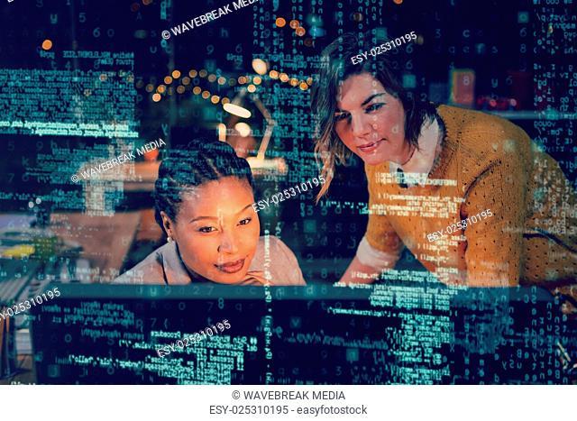 Women looking at computer 3D