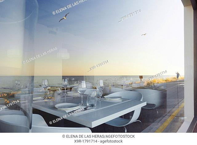 Reflected sea on a restaurant's window  Denia  Alicante  Spain
