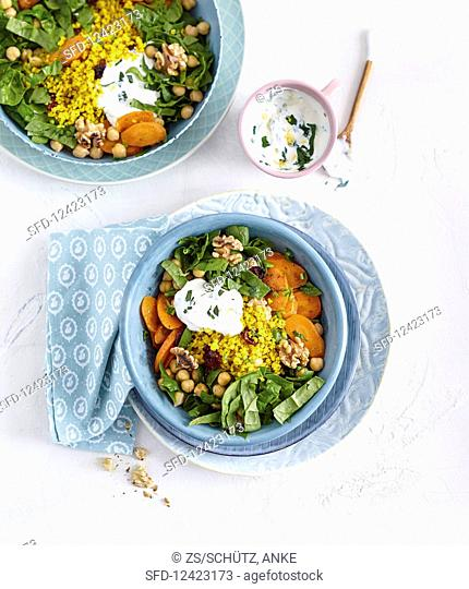 A Buddha bowl with bulgur, chickpeas and cranberries