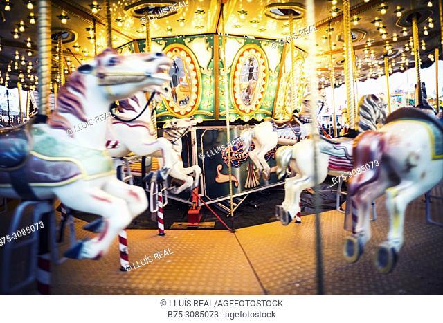 Horses on a fairground carousel at Winter Wonderland in Hyde Park. Hyde Park, London, England