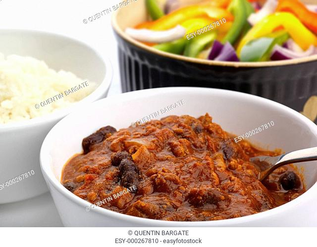 Chiili con carne with salad and rice