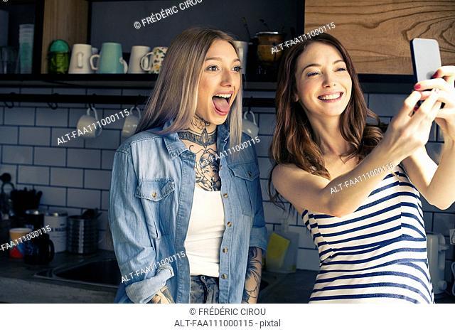 Women posing together for selfie
