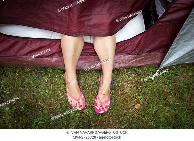 Feet outside a tent