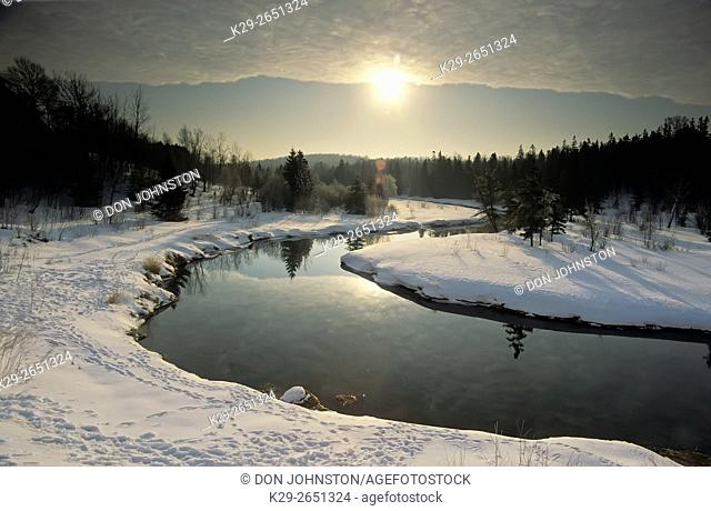Sunrise over open water of Junction Creek in winter, Greater Sudbury, Ontario, Canada