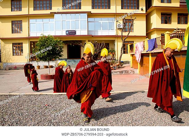 Tibetan Buddhist monks entering the temple of Gyuto monastery, Dharamshala, India