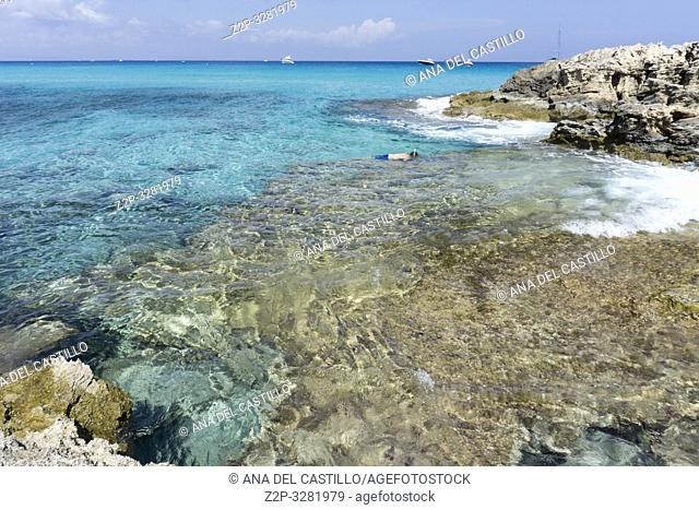 Turquoise water in Formentera Es Calo de San Agusti beach Balearic islands Spain on September 5, 2018