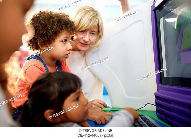 Curious kids using computer in science center