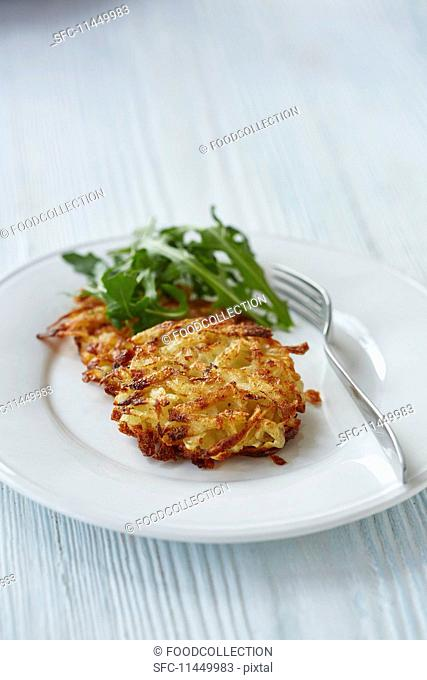 A potato fritter with rocket