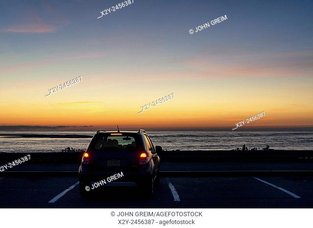 Car parked at Chatham Lighthouse Beach overlook to enjoy sunrise over the ocean, Chatham, Cape Cod, Massachusetts, USA