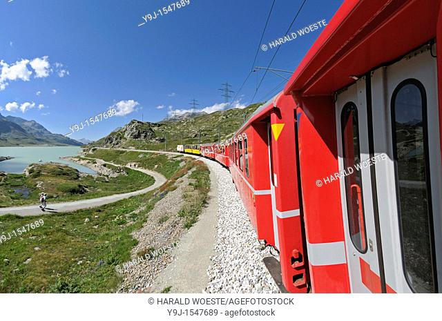 Train ride with Rhätische Bahn on the Bernina line from Ospizio Bernina to Poschiavo passing the Lago Bianco  Switzerland, Western Europe, Graubünden, Bernina