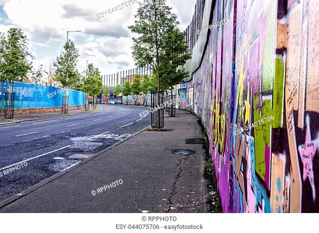 The peace lines or walls in Belfast that separate Catholic from Protestant neighborhoods