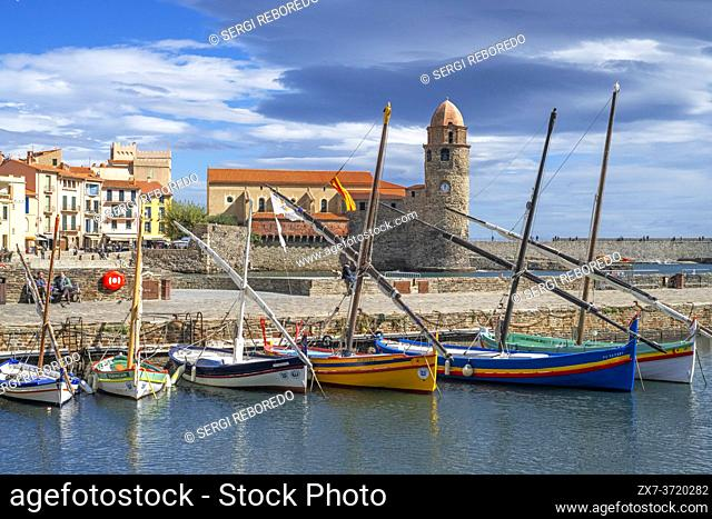 Typical boats and Notre-Dame-des-Anges church and landscape seaside beach of the picturesque village of Collioure, near Perpignan at south of France...