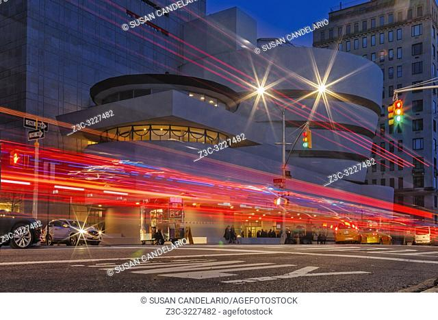 Guggenheim Museum NYC Light Streaks - View during twilight of the Solomon R. Guggenheim Museum and light trails on 89th Street and Fifth Avenue on the Upper...