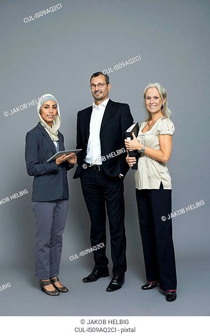 Studio portrait of two businesswomen and businessman