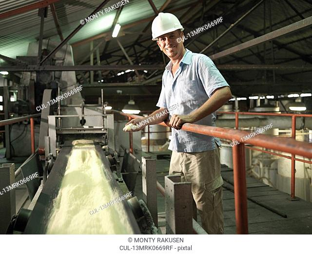 Supervisor With Processed Sugar Cane